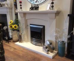 Epsom bespoke limestone fireplace