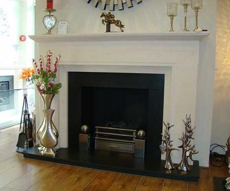 Macintosh bespoke limestone fireplace